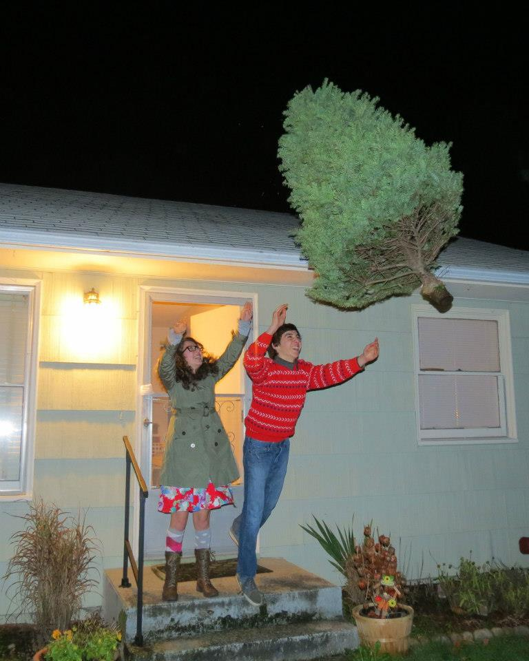 Tossing the Tree -- an old West Seattle tradition, dating back to 2010. Photo by permission only of Karen Lewis Carlos.