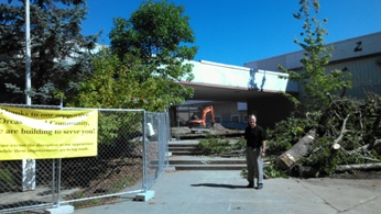"Superintendent Eric Webb stands between the new middle school building and the old ""80s building"" as construction continues apace."
