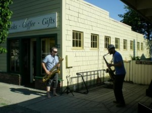 Gregory Books and Al Bently play their saxes, mean and otherwise, outside Darvill's Bookstore.